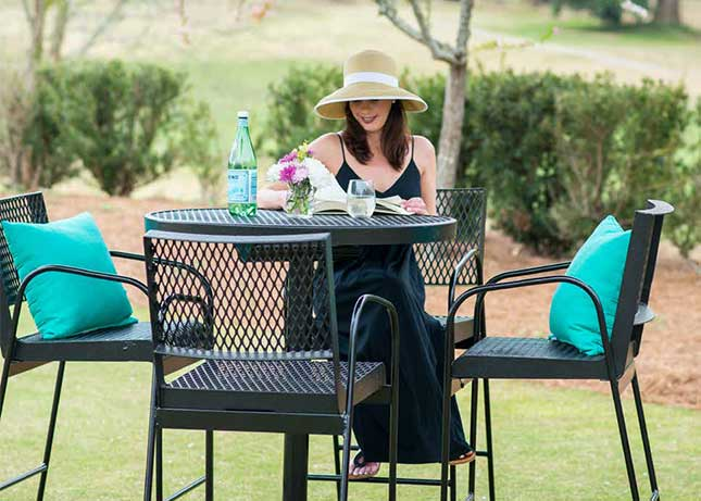 Woman sitting at a park table installed by Kraftsman