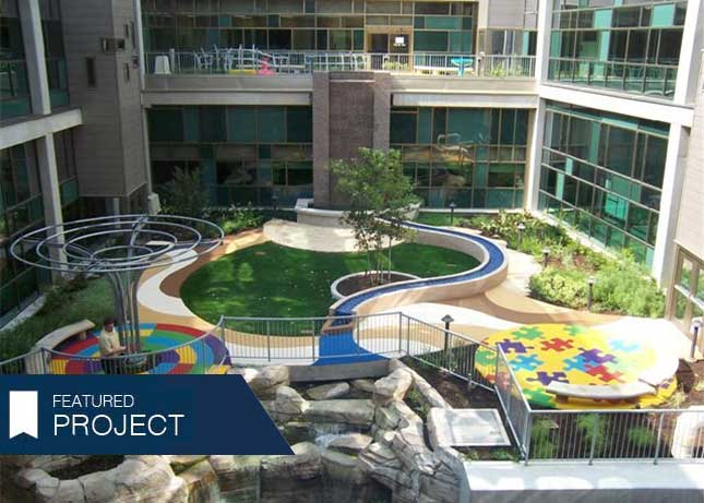 Poured-in-Place Safety Surfacing with a colorful puzzle piece pattern by Kraftsman at Dell Children's Hospital