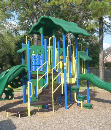 commercial playground equipment in a park installed by kraftsman - Commercial Playground Equipment