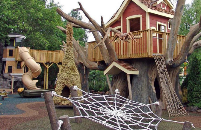 A Themed Playground with spider web climbing nets by Kraftsman
