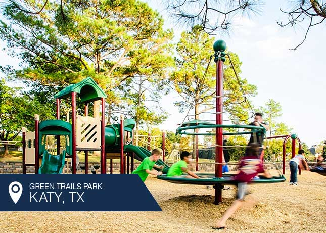Kids playing on play structures designed and built by Kraftsman at Green Trails Park in Katy, TX