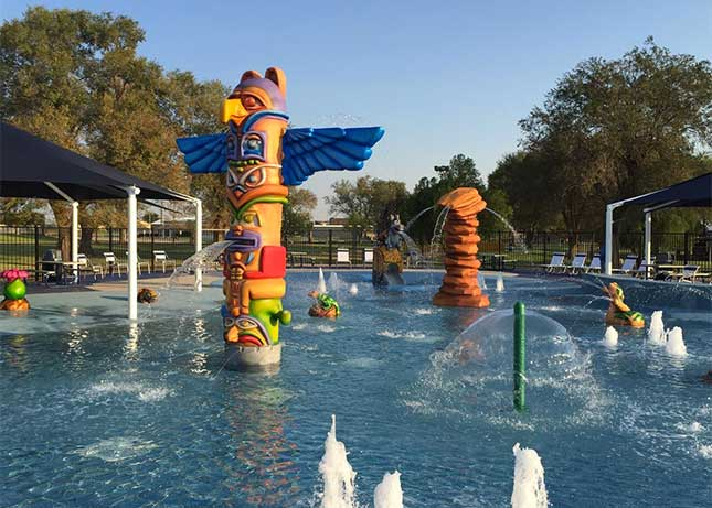 Aquatic Playground Equipment in the shape of totem poles and rock formations by Kraftsman