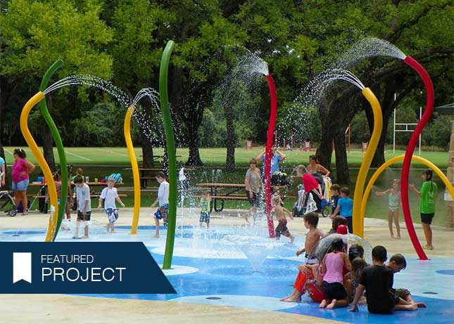 Colorful splash pad at Parr Park by Kraftsman in Grapevine, TX