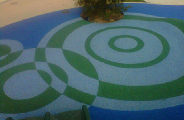 Safety Surfacing with a green and white concentric circles pattern by Kraftsman