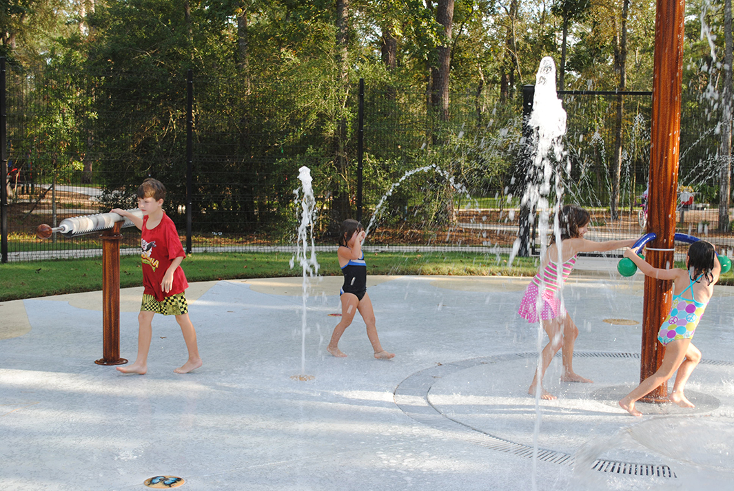 Kids playing at The Woodlands, TX Sawmill Splash Park Design Build by Kraftsman