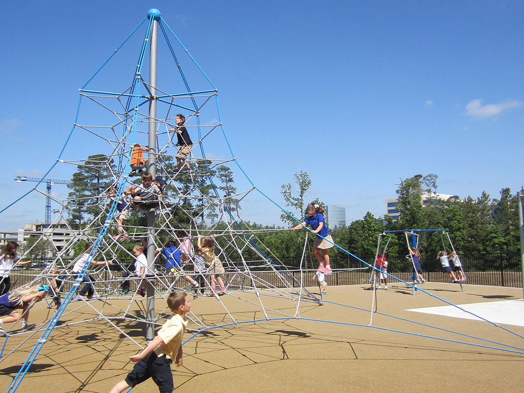 Kids Playing on The Woodlands United Methodist Church Rope Playground Climbing Nets by Kraftsman