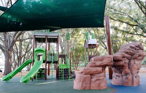 Covered playground equipment